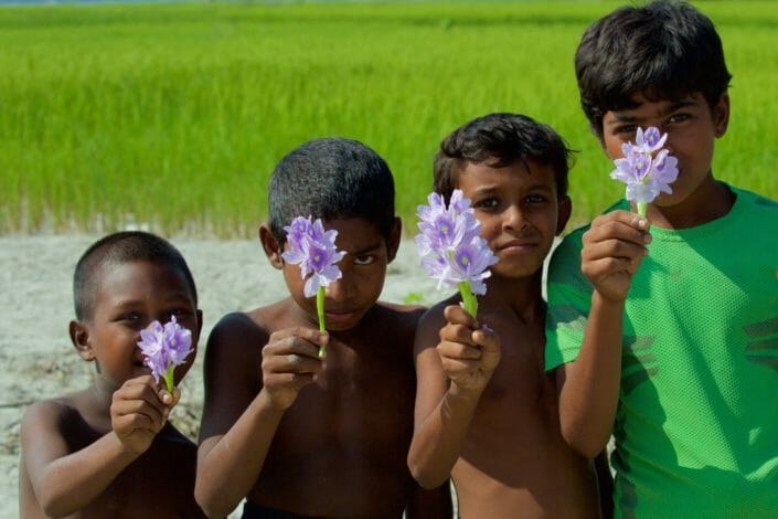 4 boys offering a flower Chars Bangladesh-11-2015